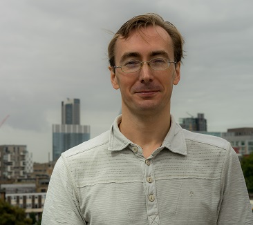 Man in glasses with london skyline background