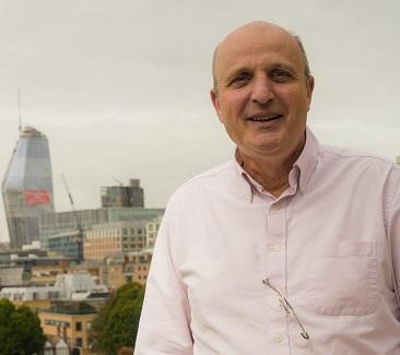 Man in shirt with london skyline background