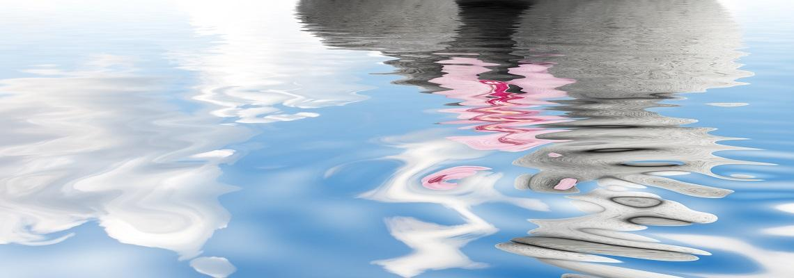 Zen stones on rippling water