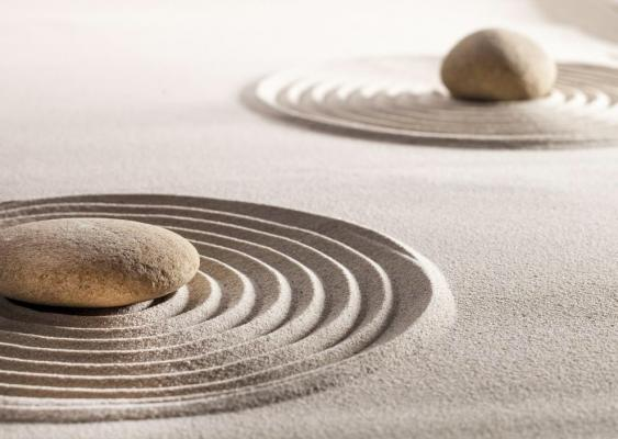 Zen stones in rippling sand