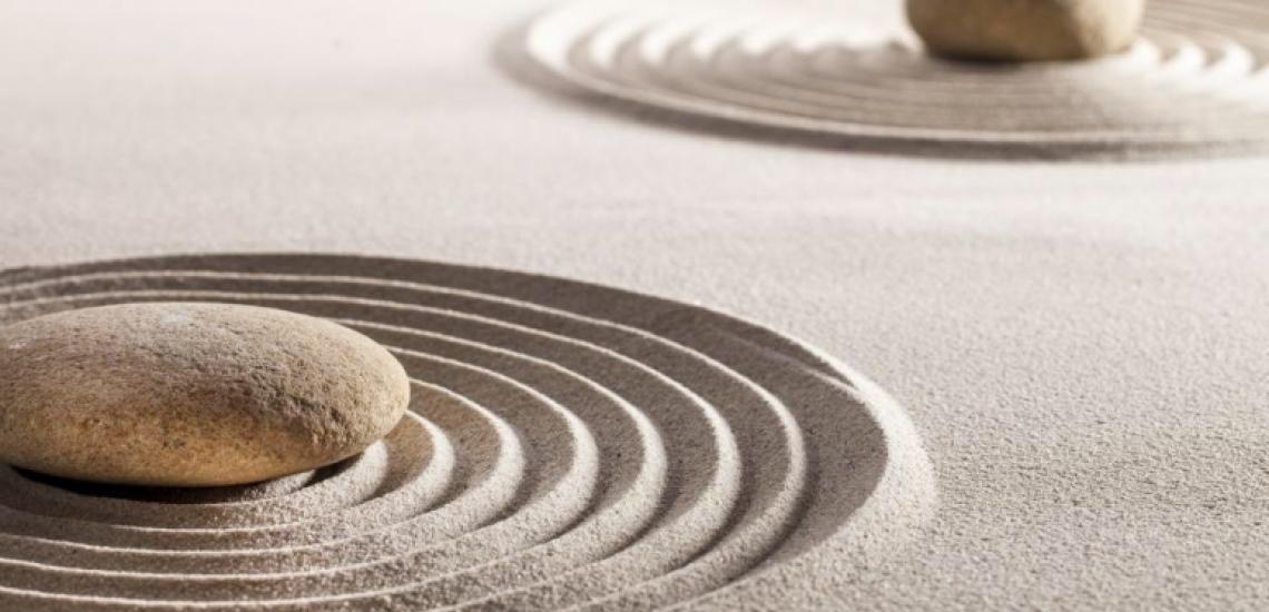 Zen stones on rippling sand