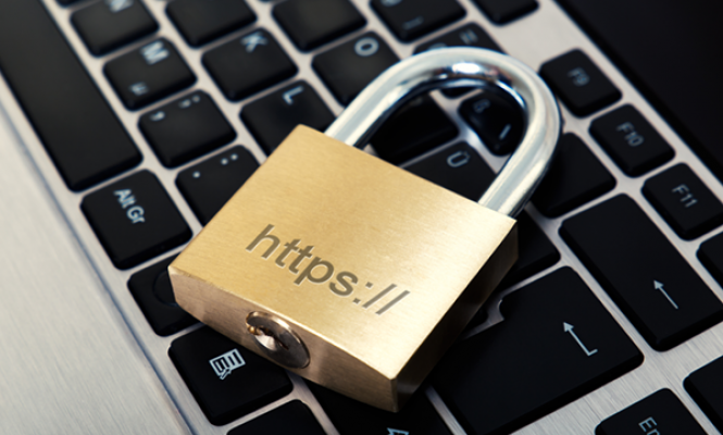 Padlock on a keyboard with https written on representing a secure website