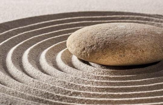 Close up of zen stone on rippling sand
